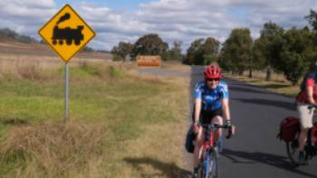 Cyclists with train signage enroute to Mudgee | Ross Baker