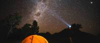 The night sky filled with bright stars over Australia's only Dark Sky Park in the Warrumbungles. | Destination NSW