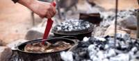 Cooking on hot coals at Camp Fearless | Guy Wilkinson