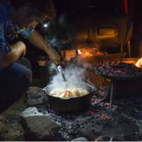 The Larapinta Guides still cook with traditional camp ovens over an open fire | Caroline Crick