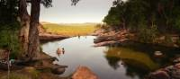 Relaxing in the waterhole above Gunlom Waterfall on the Kakadu Walking Adventure | Rhys Clarke