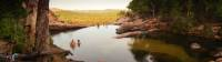 Relaxing in the waterhole above Gunlom Waterfall on the Kakadu Walking Adventure |  <i>Rhys Clarke</i>