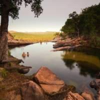 Relaxing in the waterhole above Gunlom Waterfall on the Kakadu Walking Adventure   Rhys Clarke