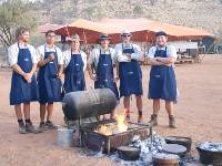 The guide team cooking up an awesome meal in the camp ovens |  <i>Chris Buykx</i>