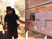 Guide Ryan giving a daily briefing using the Larapinta Trail park maps. |  <i>Ayla Rowe</i>