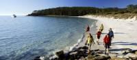 Walkers on 4 Mile Beach on Maria Island
