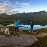 Hikers taking in the breathtaking views of Cradle Mountain and Lake St Clair | Peter Walton