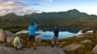 Hikers taking in the breathtaking views of Cradle Mountain and Lake St Clair |  <i>Peter Walton</i>