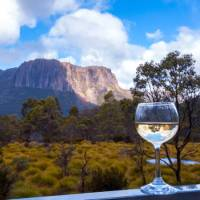 Enjoy a glass of wine after a day's trek along the Overland Track   Great Walks of Australia