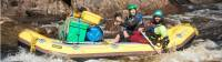 Guides navigating the raft to calmer waters |  <i>Glenn Walker</i>