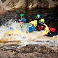 Guides taking the raft through wilder rapids | Glenn Walker