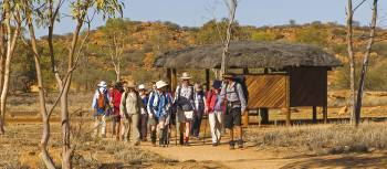 Trekkers embarking at the beginning of the Larapinta Trail, the old Telegraph Station | Peter Walton